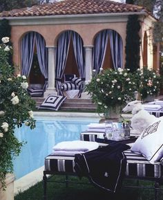 Create an outdoor getaway in your own backyard with lush pool house panels and luxurious lounge chairs in deep blues. Be sure to include plenty of comfortable pillows in your design! Outdoor Rooms, Outdoor Living, Outdoor Decor, Home Interior, Interior And Exterior, Bathroom Interior, Gazebos, Home Modern, Outside Living