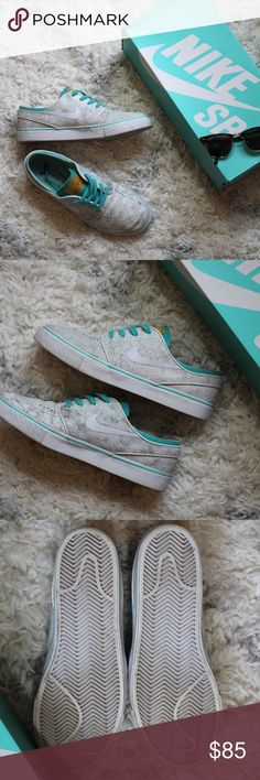 White Leather Crackle Nike SB Sneakers Worn indoors a few times, most signs of wear are on inside of soles. Teal cotton laces, white bottoms.  Men's size 8 Women's 9.5. Comes in Nike box, NOT the original box. #ellairene #skateshoes #leathersneakers #unisexshoes #zumiez #pacsum #nike #skateboarding Nike Shoes Sneakers