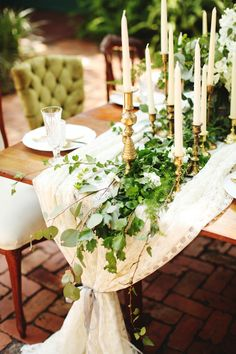 southern weddings hayley paige vine and light styled editorial shoot table ivy candles overflow