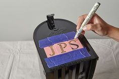 Stenciling letters on a metal mailbox