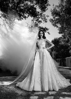 Palatial ball gown with cap sleeve and very detailed embroidered bodice with full skirt.