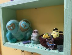 A lotta love in this photo! Please continue reading below.  @adri.hobbs sent me this shelf she hand made and painted for me. It is now hanging in my art makin' space it's so sweet and I love the color and details. (Also sent two stones by slothy)  @caraprada made these lovely needle felted owls... They usually have one head but after taking she met my request to make one with two heads it's came out great and I love their fluffy wings and opposite faces.  @whimsycalling made the squee worthy…
