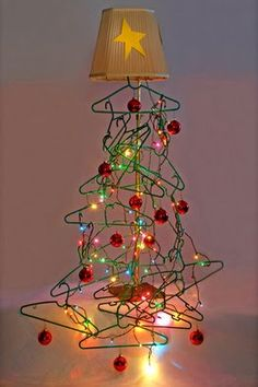 Start collecting those plastic hangers now, says Too Good to be Threw at http://TGtbT.com ... & find a great lampshade... Come the holidays, your consignment, resale or thrift shop will have a Christmas tree window display that will boggle the minds of your marketplace ;)