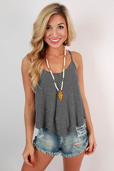 You can't go wrong with a striped flutter tank this season! This navy tank is so soft and flowy, you're never going to want to take it off!
