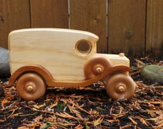 This beautifully handcrafted wooden toy panel truck will inspire imaginative and active play. This truck is made from all natural pine and redwood with a natural non toxic child safe varnish. Corners are rounded and have been hand sanded.  Approximate siz
