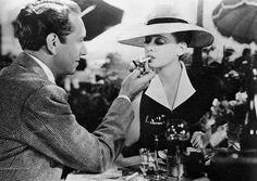 Paul Henreid lights Bette Davis cigarette in Now, Voyager
