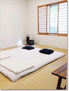 zen bedroom design: Japanese bedroom in Tokyo.   Idea for covering window well. Place a soft light behind screen.