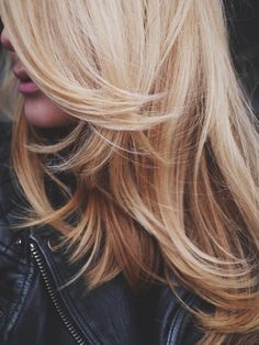 Flowy blonde waves.Image via With Grace and Guts via StyleList
