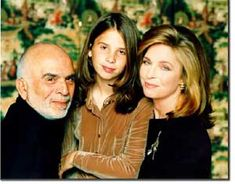 King Hussein and Queen Noor of Jordon with their daughter Princess Raiyah. Very nice picture.