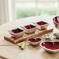 Colourful tableware - dips and nibbles, chutneys and raita?  mmm. Handmade from recycled aluminium in India.