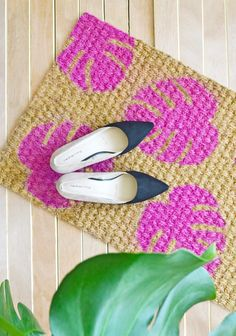 Coir doormats are pretty easy to find at big box hardware (Bunnings) and budget homewares stores. To brighten one up, try this tutorial for painting on a Monstera leaf motif. It's from Enthralling Gumption.