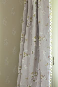 Our Ivory Apple Blossom Linen Fabric, trimmed with Pale Olive/Ivory Pom Poms and matched with Warm Olive/Shalini Wallpaper looks both charming and classic