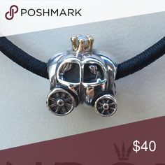 Authentic Royal Carriage Pandora charm with Pearl This charm adds color and elegance to your bracelet or necklace.  Two tone with a pearl as well.  Be sure to shop other items in my closet because I always discount bundles. Pandora Jewelry