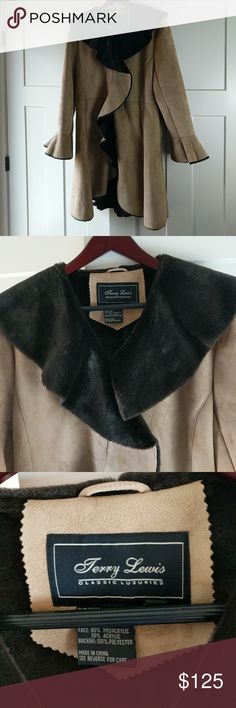 """Terry Lewis faux fur coat S Soft deep brown faux fur lining.  Faux suede exterior.  Excellent condition!  Polyester, modacrylic, and Acrylic.  A classic luxury complete with ruffle.  4 Eye and hook closures.  37"""" too to bottom at the longest point.  20"""" arm pit to arm pit.  18.5"""" arm pit to end of sleeve; 24.5"""" shoulder seam to end of sleeve; 5 1/4"""" collar seam to shoulder seam. Terry Lewis Jackets & Coats"""