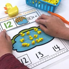 April Morning Work.  43 Spring Activities to engage and delight including this Counting On Quacks fine motor counting activity.  Come check them all out.