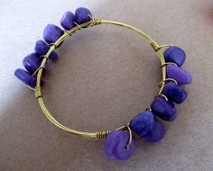 Dark purple stones on gold bangle adds a pop of color to your jewelry and bracelet collection. Get it now at www.rocmeout.com