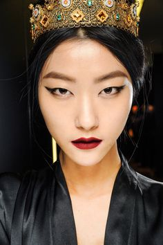 Ji Hye Park backstage at Dolce and Gabbana Fall/Winter 2013. Makeup by Pat McGrath. On lips: Dolce and Gabbana Ultra and Amethyst.