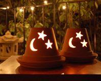 Lumières extérieures en pots de terre cuite...