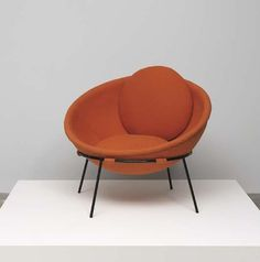 "LINA BO BARDI Rare large ""Bowl"" chair, ca. 1951  Formed aluminum, painted iron, fabric, brass. 28 in. (71.1 cm) high Manufactured by Ambiente, Italy."