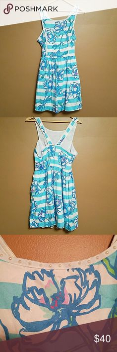 VGUC Lilly Pulitzer Fit and Flare Dress 10 Adorable Lilly summer dress in a size 10. Side zip and pockets! All beads are secured. Worn a handful of times but no visible signs of wear (atains, undone hems, pilling, etc). From a smoke-free home :) Lilly Pulitzer Dresses Mini
