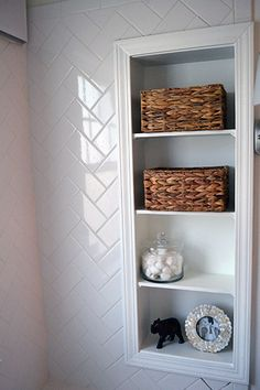 tile and shelves Bathroom shelves filled with brown crates - built into wall?