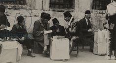 The public letter writer helps with letters for illiterate people, Turkey, 1922 (b/w photo) Image ID: NGE 420758