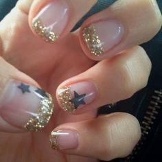 Rockstar nails but black! Maybe f Gold or silver Star