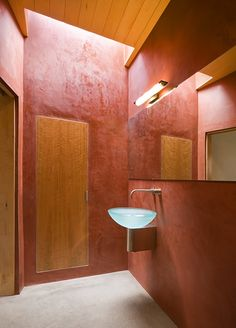 A bright bathroom built to accommodate wheelchair access to a shower and bath.
