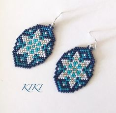 Squill beaded peyote earrings is ready - my own design This pattern is available at: www.kikisbeads.com/squillearrings #earrings #jewelry #beadedjewelry #beadedearrings #peyote #earrings #beaded #miyukibeads #beads #delicabeads #floral #elegant #miyukibeads #duracoat #delica #miyuki #colorful #beadwork #jewelry #handmade #unique #flower #handmadegift #handmadejewellery #colorful #uniquegift #handmadejewelry #peyotestitch #beading #mydesign