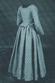 A Dress of the Revolution - worn for escape - 1793.This pattern is taken from a dress of 1793 which originally belonged to a boatwoman on the River Seine in Paris. A Frenchwoman - married to an Englishman - was escaping from the terrors of the French Revolution and borrowed this dress to conceal her identity. Her ruse was successful and she reached England.