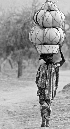 Woman in Dogon, Mali by Norbert Righetto.