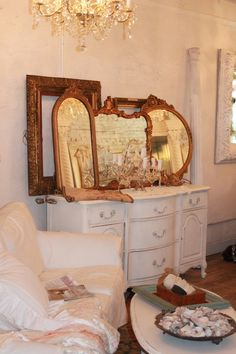 use the large (unused) dresser mirror in the bathroom - paint white and 'shabby chic' it :)