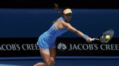 Ana Ivanovic of Serbia hits a return to Serena Williams of the U.S. during their women's singles match at the Australian Open 2014 tennis to...