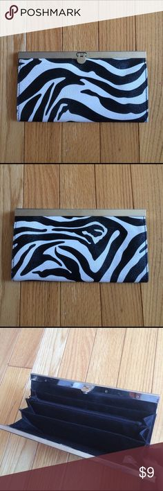 Zebra Wallet Magnetic clasp shut. Has compartments for change money and cards. Bags Wallets