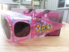 Pink Fan Fares Over The Glasses Frames with .40 completed with Blue and Yellow.