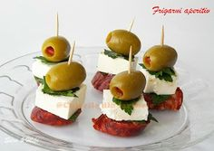 Ingredients: * Chorizo ​​sausage * Cheese, goat cheese, feta * Green olives * Parsley *Toothpick Method: meat, no matter what type it is, is dried and cut into 1 cm thick. Cheese cut into cubes. Put a piece of meat and a cube of cheese and an olive green above with each other and with a toothpick