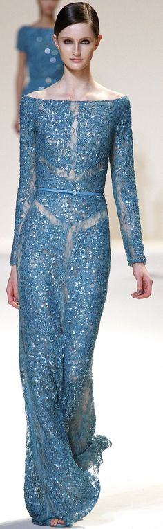 Model is far too skinny but what a lovely dress. It'd be rocking on someone with curves