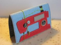 I would like a large needle book like this..the machine and colors are too cute :)