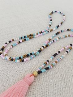 Long glass bead tassel necklace with a pink por Brightnewpenny