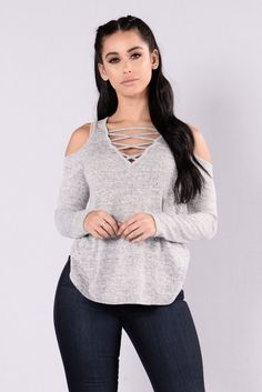 - Available in White/Black and Mustard/Black - Cold Shoulder Top - Long Sleeve - V Neckline - Strappy Chest Design - Loose Fit - Made in USA - 97% Polyester 3% Spandex