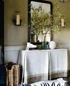 Rectangular inverted pleat table skirt. Contrast banding with decorative set above and welting along the top edge of the table.