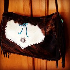 """The new Micah Bag.   14""""wide, 9"""" high and 5"""" deep with a long cross body strap with fringe and turquoise stones. A large flap features your initial or brand. From gowestdesigns.us"""
