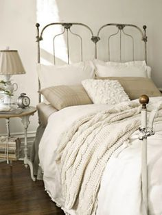 cast iron bed from country living - love the texture in the neutral linens