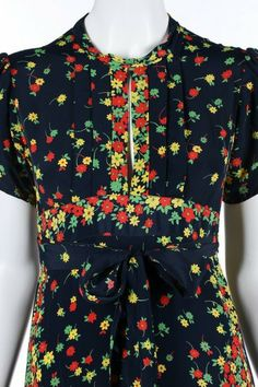 An Ossie Clark/Celia Birtwell floral printed navy : Lot 184