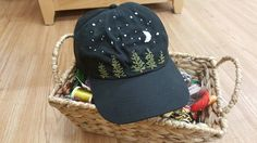 pine trees and stars hand embroidered on an adjustable hat