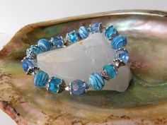 Hey, I found this really awesome Etsy listing at https://www.etsy.com/listing/466766922/ocean-blue-beaded-bracelet-handmade