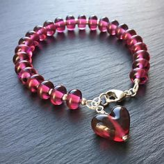 Lampwork glass and sterling silver 'Cherry Jam' bracelet by Laura Sparling See this Instagram photo by @beadsbylaura • 109 likes