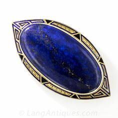 Art Deco Lapis and Enamel Brooch. Bold and striking 1920s Art Deco design comes shining through in rich royal blue in this 2 and 3/8 inch long lapis lazuli brooch, farmed in 14K yellow gold and outlined with cobalt enamel tracery. A big beautiful bauble.