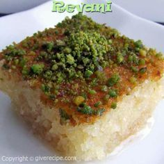 """Semolina cake soaked in sweet syrup and topped with pistachio ... in Arabic we call it """"Haressa"""""""