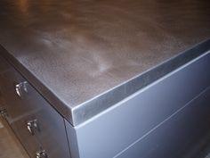 Textured zinc island countertop.